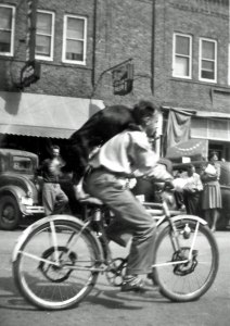 Dad in the town parade with his dog